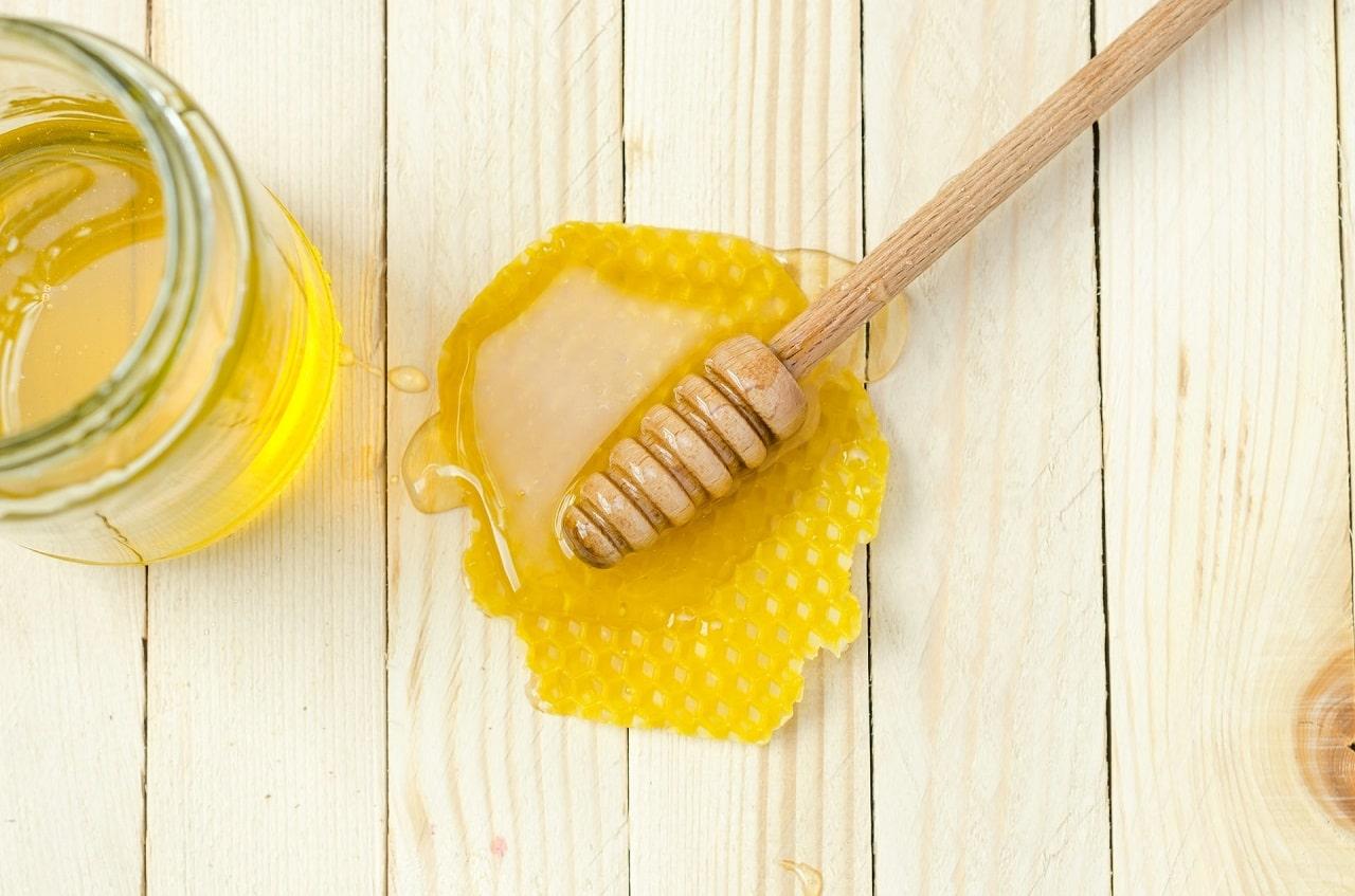 fresh honey isolated on table