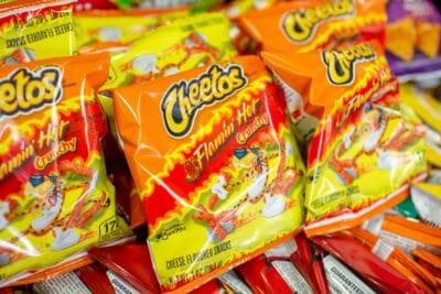 Several bags of Cheetos Flamin' Hot Crunchy