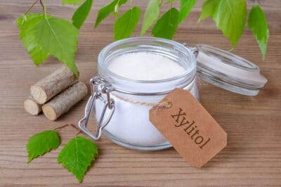 A jar of xylitol on a table.
