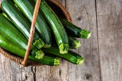 Fresh zucchini, green vegetables on local farmer market
