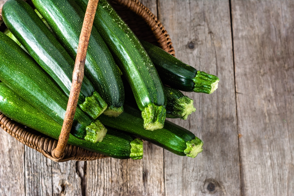 Fresh zucchini, green vegetables on local farmer market